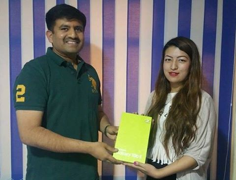 CEO of MEX Nepal, Mr. Jitesh Surendran, giving away the Samsung Tab E to the winner of the MEX Selfie Contest, Ms. Barsha Maharjan